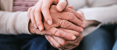 holding older adult hand